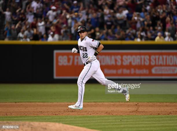 Jake Lamb of the Arizona Diamondbacks rounds the bases after hitting a grand slam home run during the seventh inning against the Los Angeles Dodgers...