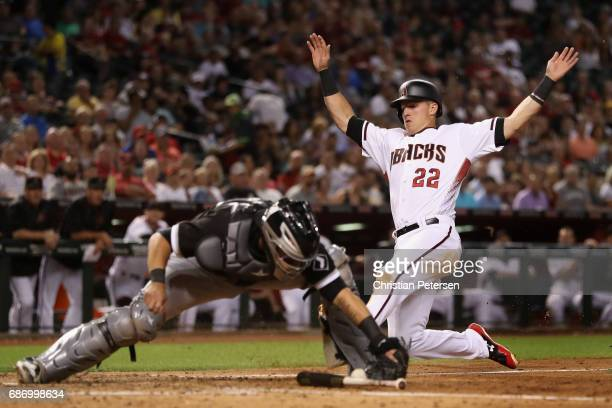 Jake Lamb of the Arizona Diamondbacks safely slides into home plate to score past catcher Omar Narvaez of the Chicago White Sox during the sixth...