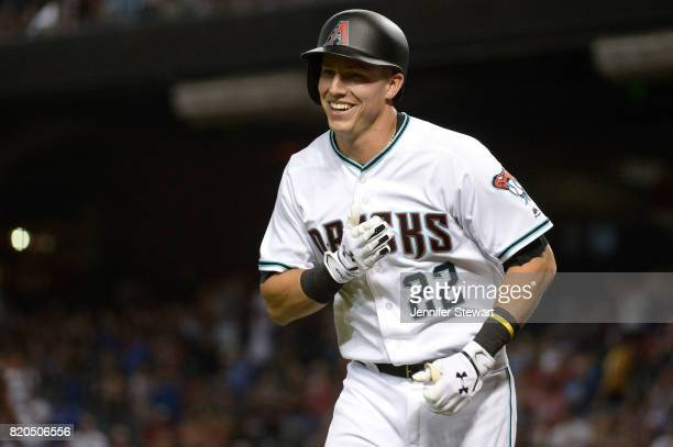 Jake Lamb of the Arizona Diamondbacks smiles after hitting a solo homer during the first inning of the MLB game against the Washington Nationals at...