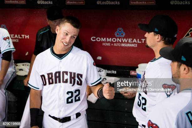 Jake Lamb of the Arizona Diamondbacks smiles in the dugout prior to a game against the Los Angeles Dodgers at Chase Field on August 8 2017 in Phoenix...