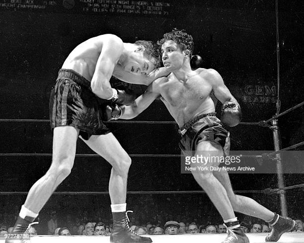 Jake LaMotta throws a right and gets ready with a left in bout against Fritzie Zivic