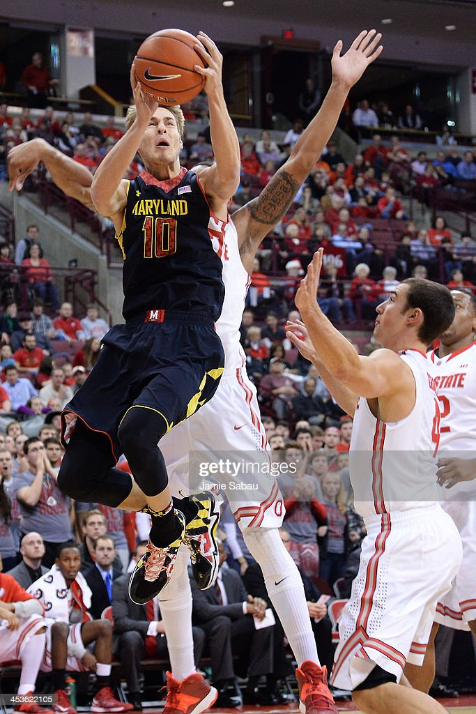 Jake Layman #10 of the Maryland Terrapins drives to the basket as <a gi-track='captionPersonalityLinkClicked' href=/galleries/search?phrase=Aaron+Craft&family=editorial&specificpeople=7348782 ng-click='$event.stopPropagation()'>Aaron Craft</a> #4 of the Ohio State Buckeyes defends in the first half on December 4, 2013 at Value City Arena in Columbus, Ohio. Ohio State defeated Maryland 76-60.