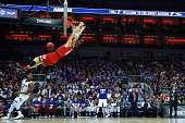 Jake Layman of the Maryland Terrapins dunks the ball in the first half against the Kansas Jayhawks during the 2016 NCAA Men's Basketball Tournament...