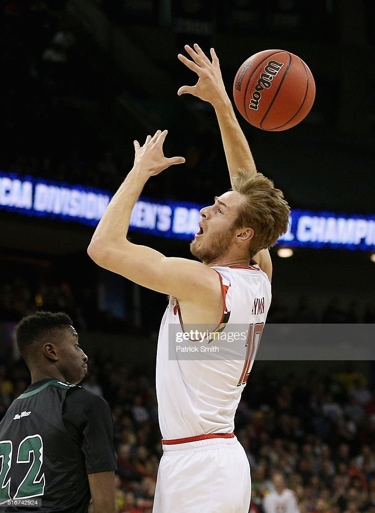 <a gi-track='captionPersonalityLinkClicked' href=/galleries/search?phrase=Jake+Layman&family=editorial&specificpeople=9973489 ng-click='$event.stopPropagation()'>Jake Layman</a> #10 of the Maryland Terrapins loses control of the ball against the Hawaii Warriors in the first half during the second round of the 2016 NCAA Men's Basketball Tournament at Spokane Veterans Memorial Arena on March 20, 2016 in Spokane, Washington.