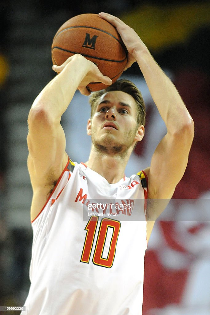 <a gi-track='captionPersonalityLinkClicked' href=/galleries/search?phrase=Jake+Layman&family=editorial&specificpeople=9973489 ng-click='$event.stopPropagation()'>Jake Layman</a> #10 of the Maryland Terrapins takes a foul shot during a college basketball game against the Virginia Cavaliers at the XFinity Center on December 3, 2014 in College Park, Maryland. The Cavaliers won 76-55.