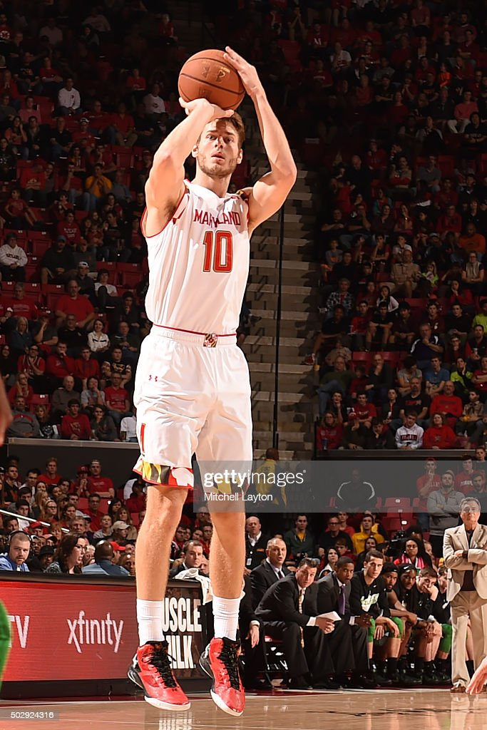 <a gi-track='captionPersonalityLinkClicked' href=/galleries/search?phrase=Jake+Layman&family=editorial&specificpeople=9973489 ng-click='$event.stopPropagation()'>Jake Layman</a> #10 of the Maryland Terrapins takes a jump shot during a college basketball game against the Marshall Thundering Herd at the Xfinity Center on December 27, 2015 in College Park, Maryland. The Terrapins won 87-67.