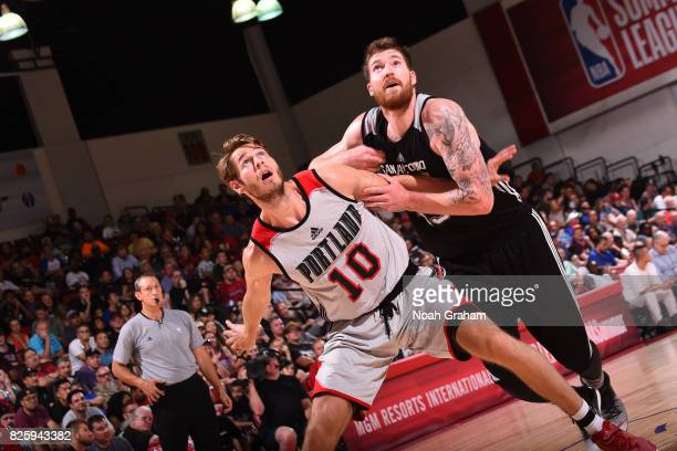Jake Layman of the Portland Trail Blazers boxes out Shayne Whittington of the San Antonio Spurs during the 2017 Las Vegas Summer League game on July...