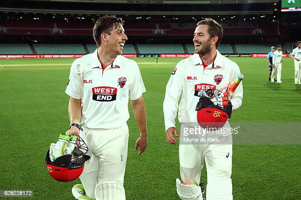Jake Lehmann and Chadd Sayers of the SA Redbacks celebrate after winning the match during day three of the Sheffield Shield match between South...