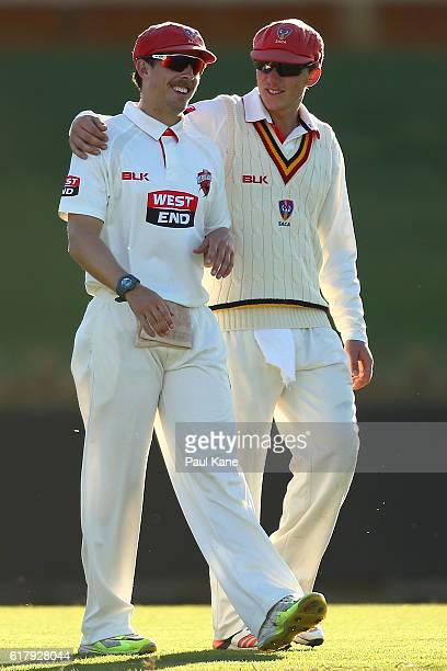Jake Lehmann and Kelvin Smith of the Redbacks share a moment during day one of the Sheffield Shield match between Western Australia and South...