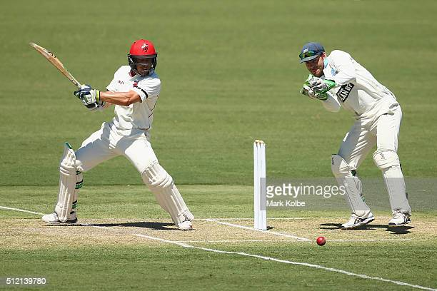 Jake Lehmann of the Redbacks bats as Ryan Carters of the Blues watches on during day one of the Sheffield Shield match between New South Wales and...