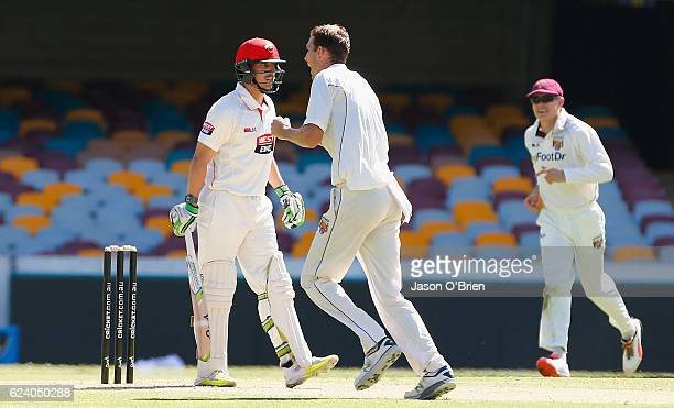 Jake Lehmann of the Redbacks is dismissed by Peter George during day two of the Sheffield Shield match between Queensland and South Australia at The...