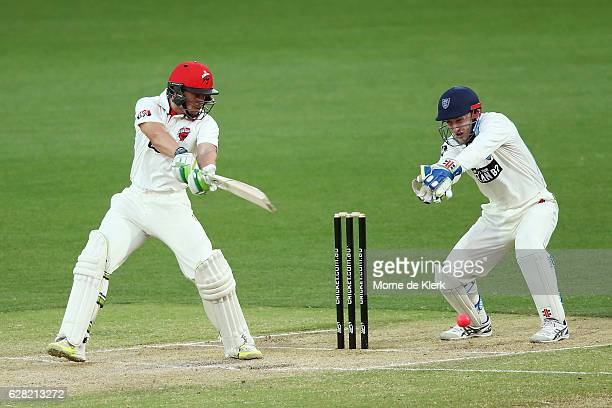 Jake Lehmann of the SA Redbacks bats in front of Peter Nevill of the NSW Blues during day three of the Sheffield Shield match between South Australia...