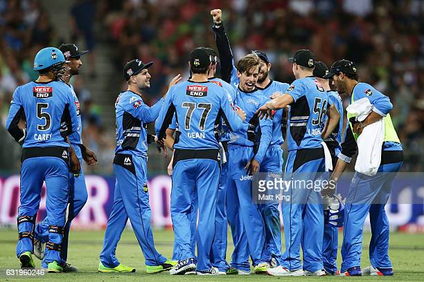 Jake Lehmann of the Strikers celebrates with team mates after taking the wicket of Shane Watson of the Thunder during the Big Bash League match...