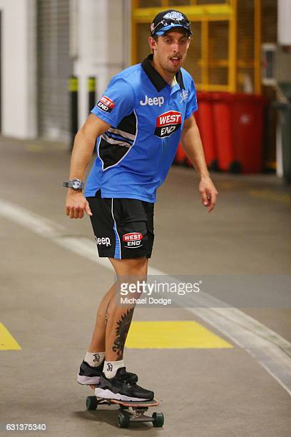 Jake Lehmann of the Strikers is seen skate boarding in carpark next to changerooms during the Big Bash League match between the Melbourne Stars and...