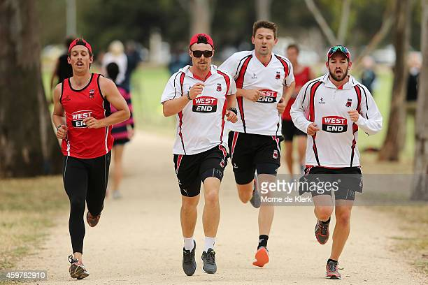 Jake Lehmann Travis Head Kane Richardson and Chadd Sayers runs around the uniloop during a South Australian Redbacks training session at The Uni Loop...