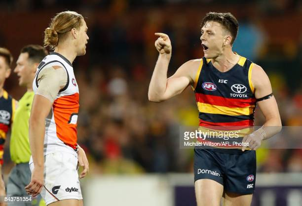 Jake Lever of the Crows and Harrison Himmelberg of the Giants exchange words during the AFL First Qualifying Final match between the Adelaide Crows...