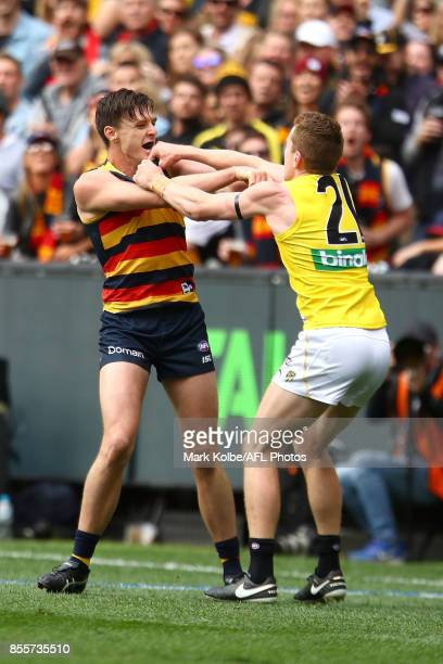 Jake Lever of the Crows and Jacob Townsend of the Tigers scuffle during the 2017 AFL Grand Final match between the Adelaide Crows and the Richmond...