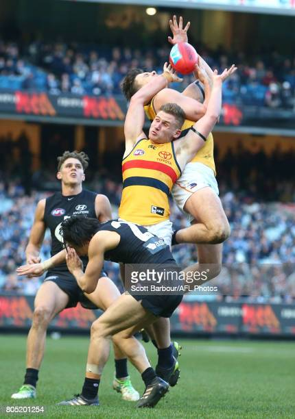 Jake Lever of the Crows and Rory Laird of the Crows compete for the ball during the round 15 AFL match between the Carlton Blues and the Adelaide...