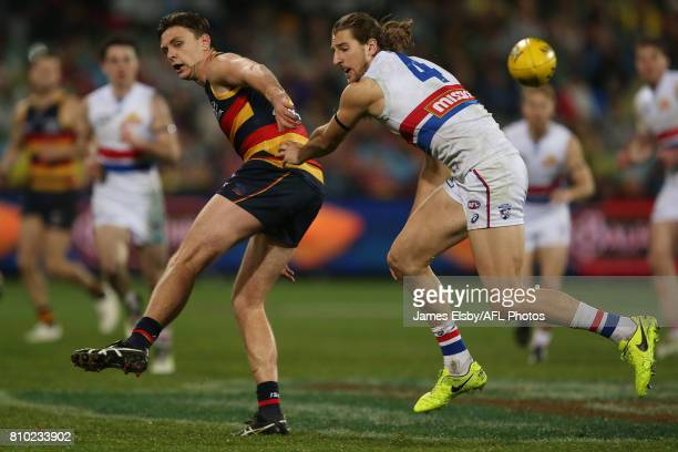 Jake Lever of the Crows competes with Marcus Bontempelli of the Bulldogs during the 2017 AFL round 16 match between the Adelaide Crows and the...
