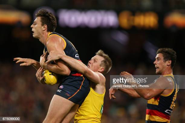 Jake Lever of the Crows is tackled by Jack Riewoldt of the Tigers during the 2017 AFL round 06 match between the Adelaide Crows and the Richmond...