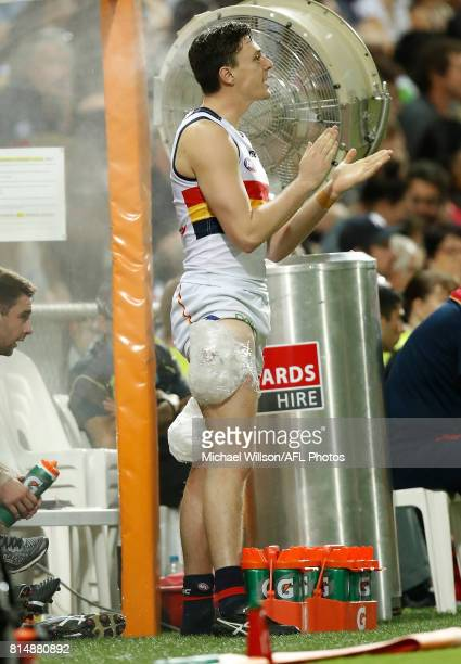 Jake Lever of the Crows looks on with ice on his legs during the 2017 AFL round 17 match between the Melbourne Demons and the Adelaide Crows at TIO...