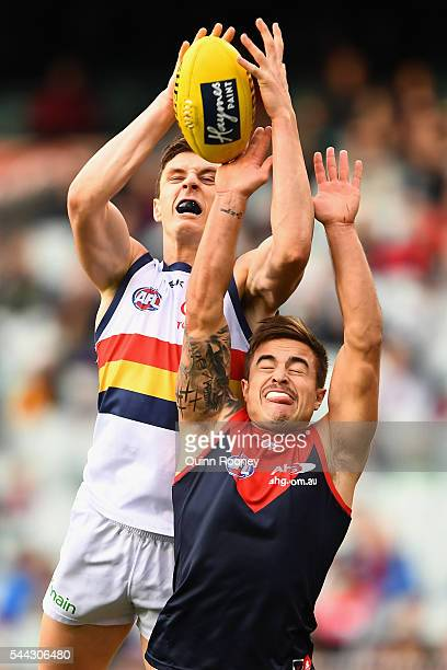 Jake Lever of the Crows marks over the top of Ben Kennedy of the Demons during the round 15 AFL match between the Melbourne Demons and the Adelaide...