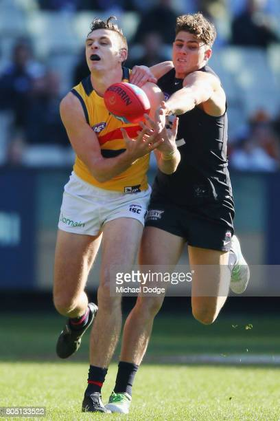 Jake Lever of the Crows marks the ball against Charlie Curnow of the Blues during the round 15 AFL match between the Carlton Blues and the Adelaide...