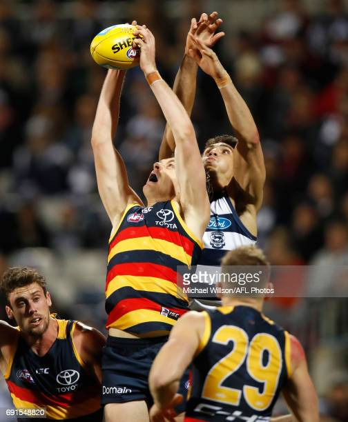 Jake Lever of the Crows marks the ball ahead of Nakia Cockatoo of the Cats during the 2017 AFL round 11 match between the Geelong Cats and the...