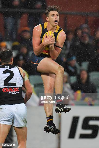 Jake Lever of the Crows marks the ball during the round 20 AFL match between the Adelaide Crows and the Port Adelaide Power at Adelaide Oval on...