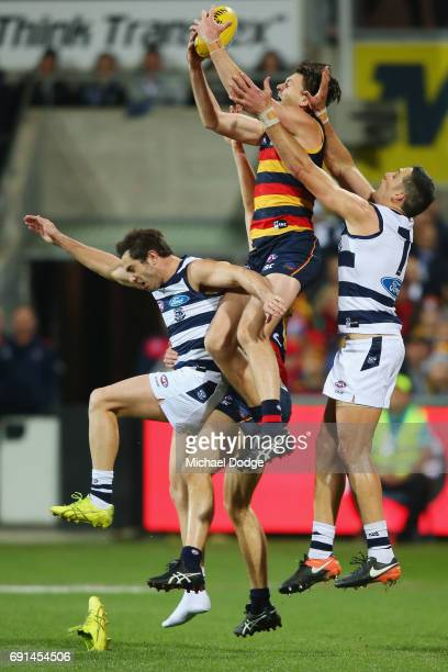 Jake Lever of the Crows marks the ball over Daniel Menzel of the Cats who loses his boot during the round 10 AFL match between the Collingwood...