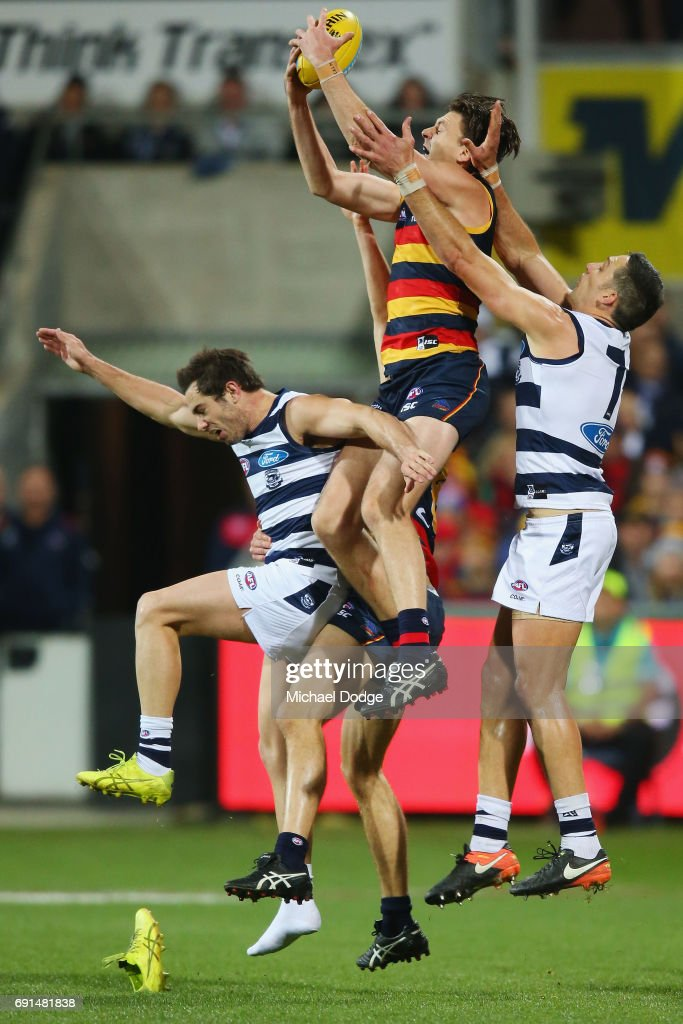 Jake Lever of the Crows marks the ball over Daniel Menzel of the Cats who loses his boot during the round 11 AFL match between the Geelong Cats and the Adelaide Crows at Simonds Stadium on June 2, 2017 in Geelong, Australia.