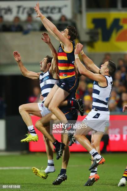 Jake Lever of the Crows marks the ball over Daniel Menzel of the Cats who loses his boot during the round 11 AFL match between the Geelong Cats and...