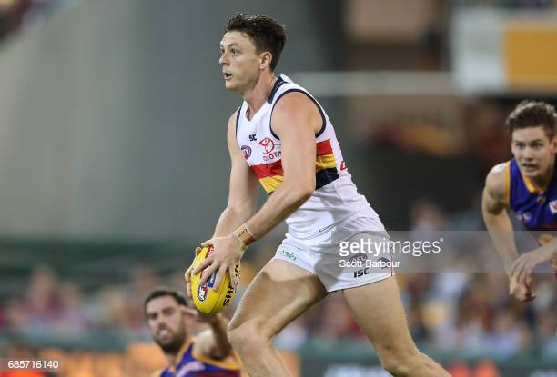 Jake Lever of the Crows runs with the ball during the round nine AFL match between the Brisbane Lions and the Adelaide Crows at The Gabba on May 20...
