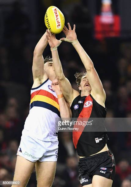 Jake Lever of the Crows spoils a mark by Joe Daniher of the Bombers during the round 21 AFL match between the Essendon Bombers and the Adelaide Crows...