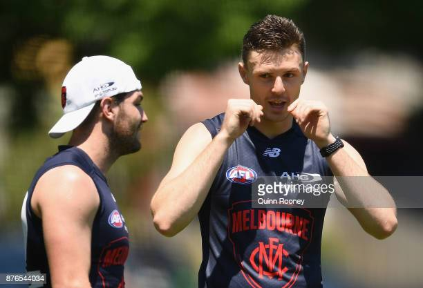 Jake Lever of the Demons speaks to Tomas Bugg during a Melbourne Demons AFL preseason training session at Gosch's Paddock on November 20 2017 in...