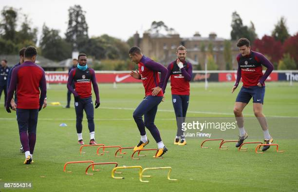 Jake Livermore and Harry Maguire of England warm up during an England training session at Hotspur Way on October 4 2017 in Enfield England