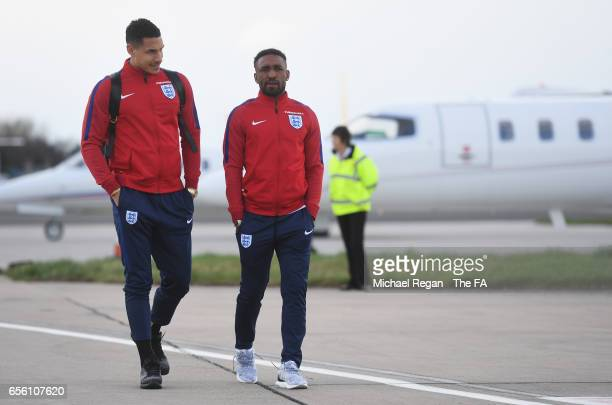 Jake Livermore and Jermain Defoe of England walk to the plane as they leave for the International Friendly match against Germany at Birmingham...