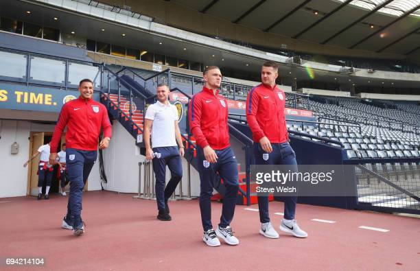 Jake Livermore Ben Gibson Kieran Trippier and Tom Heaton of England walk on the pitch on the eve of their FIFA World Cup qualifier against Scotland...