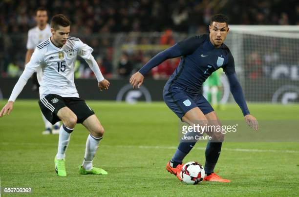Jake Livermore of England and Julian Weigl of Germany in action during the international friendly match between Germany and England at Signal Iduna...