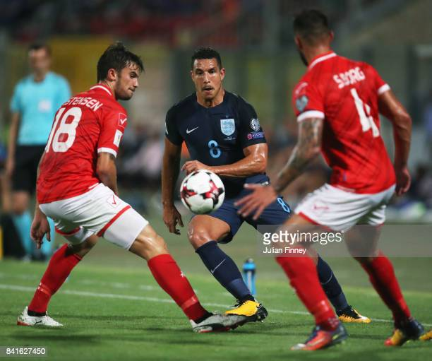 Jake Livermore of England is faced by Bjorn Kristensen and Steve Borg of Malta during the FIFA 2018 World Cup Qualifier between Malta and England at...