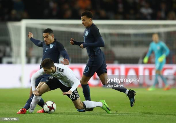 Jake Livermore of England tackles Julian Weigl of Germany during the international friendly match between Germany and England at Signal Iduna Park on...