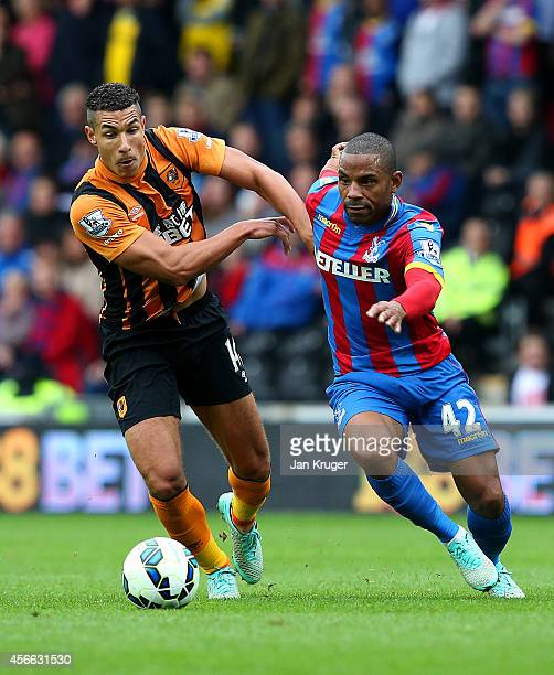 Jake Livermore of Hull City battles for the ball with Jason Puncheon of Crystal Palace during the Barclays Premier League match between Hull City and...