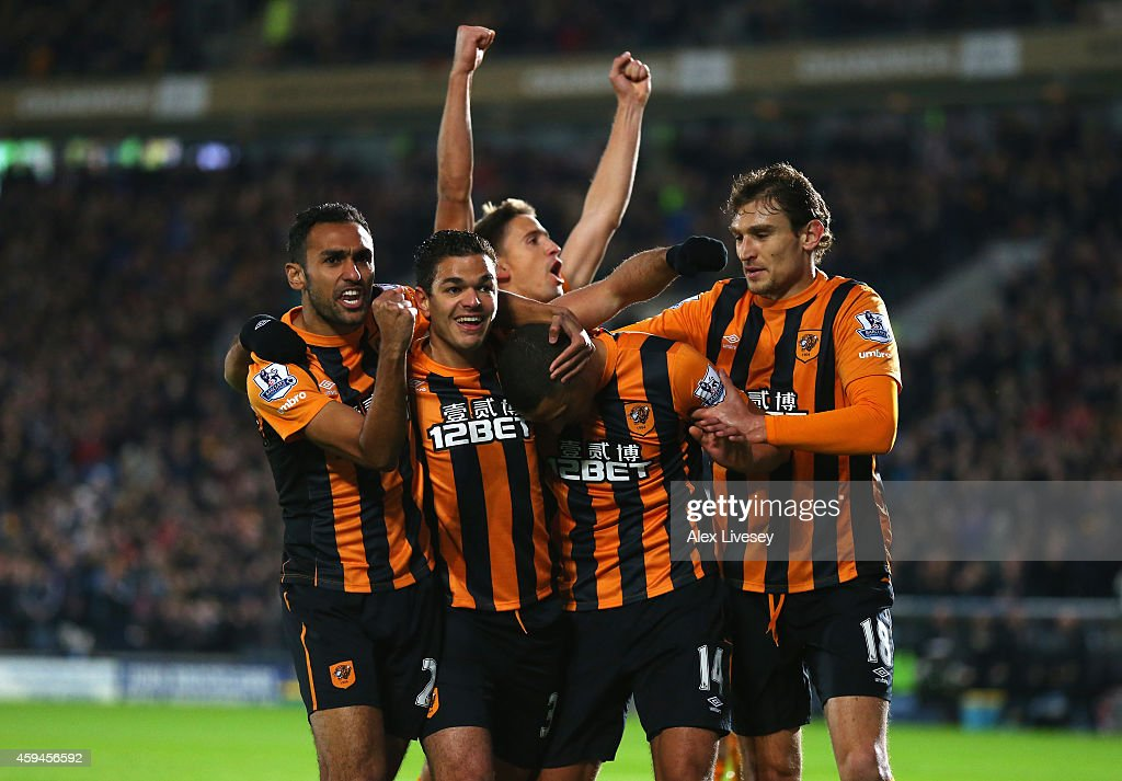 <a gi-track='captionPersonalityLinkClicked' href=/galleries/search?phrase=Jake+Livermore&family=editorial&specificpeople=5985311 ng-click='$event.stopPropagation()'>Jake Livermore</a> of Hull City is mobbed by team mates after scoring the opening goal during the Barclays Premier League match between Hull City and Tottenham Hotspur at KC Stadium on November 23, 2014 in Hull, England.