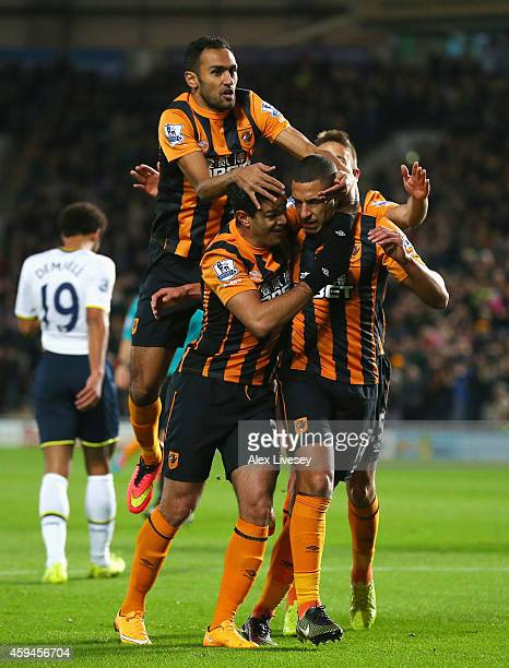 Jake Livermore of Hull City is mobbed by team mates after scoring the opening goal during the Barclays Premier League match between Hull City and...