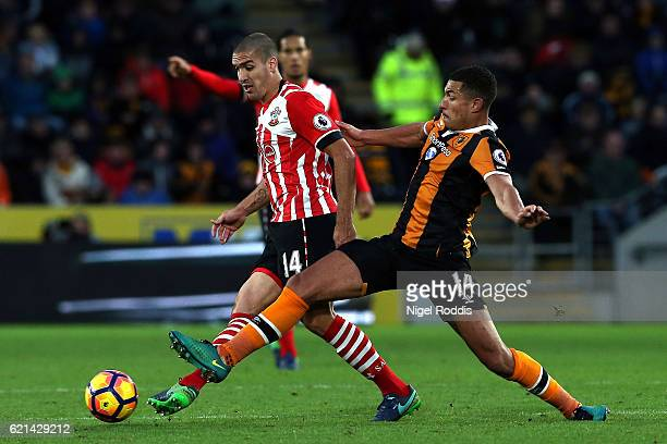 Jake Livermore of Hull City tackles Oriol Romeu of Southampton during the Premier League match between Hull City and Southampton at KC Stadium on...