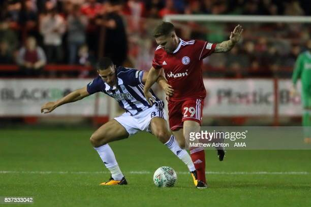 Jake Livermore of West Bromwich Albion and Billy Kee of Accrington Stanley during the Carabao Cup Second Round match between Accrington Stanley and...