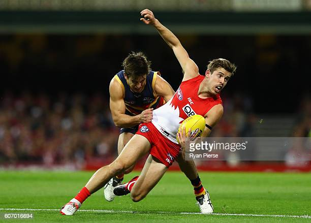 Jake Lloyd of the Swans is tackled by Jarryd Lyons of the Crows during the First AFL Semi Final match between the Sydney Swans and the Adelaide Crows...