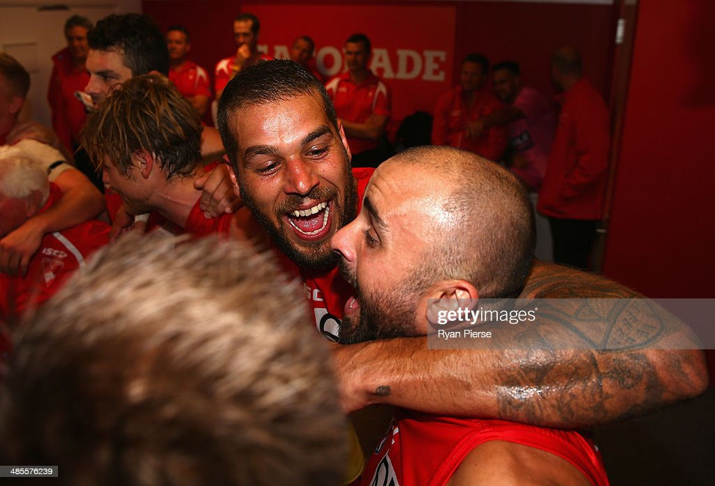 Jake Lloyd of the Swans sings the club song after his first AFL match, the round five AFL match between the Sydney Swans and the Fremantle Dockers at Sydney Cricket Ground on April 19, 2014 in Sydney, Australia.