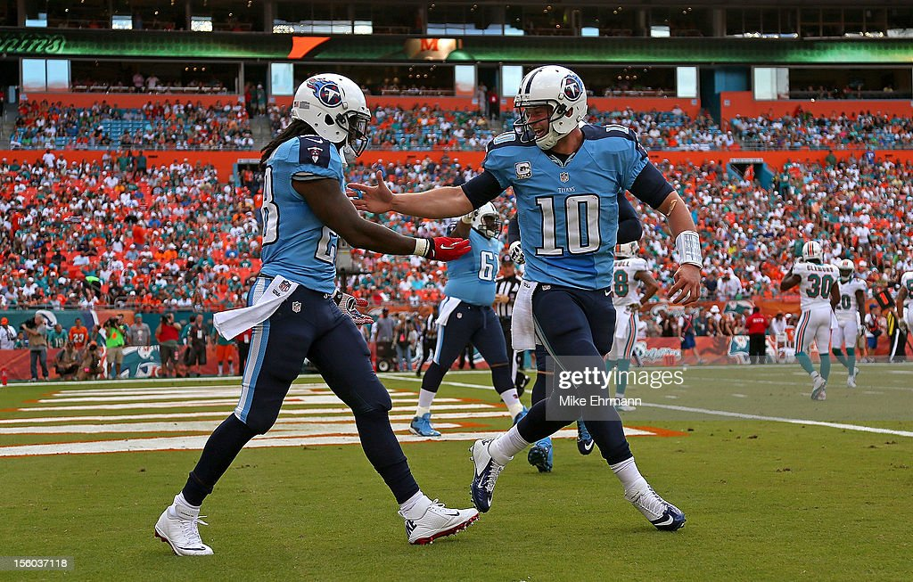 Jake Locker and Chris Johnson of the Tennessee Titans celebrate a touchdown during a game against the Miami Dolphins at Sun Life Stadium on November...
