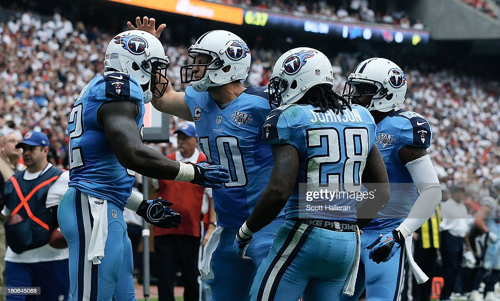 <a gi-track='captionPersonalityLinkClicked' href=/galleries/search?phrase=Jake+Locker&family=editorial&specificpeople=4450185 ng-click='$event.stopPropagation()'>Jake Locker</a> #10 of the Tennessee Titans celebrates with <a gi-track='captionPersonalityLinkClicked' href=/galleries/search?phrase=Delanie+Walker&family=editorial&specificpeople=618377 ng-click='$event.stopPropagation()'>Delanie Walker</a> #82 after a touchdown in the second half against the Houston Texans at Reliant Stadium on September 15, 2013 in Houston, Texas.